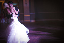 bride and groom dancing their first dance as a married couple