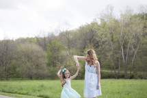 mother twirling her daughter