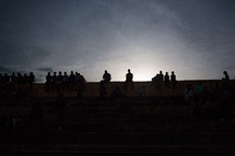 Fans watching a track meet in East Africa