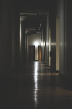 A light shining at the end of a dark hallway.