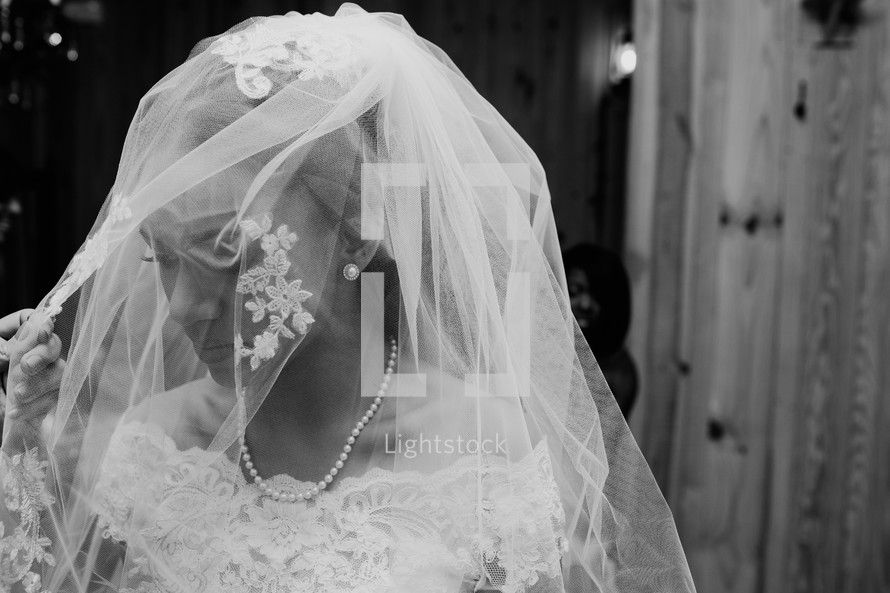 A bride with veil over her face.
