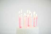 flames on candles on a birthday cake