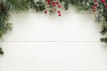 pine garland and berry bordered background.