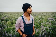 a man in a field of wildflowers