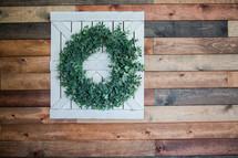 boxwood wreath on a barn door