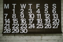 Calendar hung on a brick wall