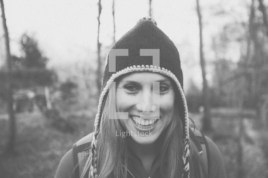 smiling woman in a wool cap