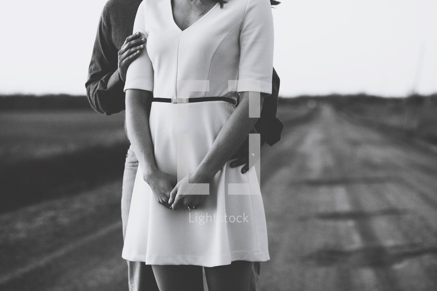 couple standing on a rural road