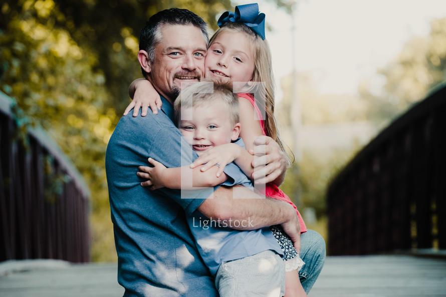 grandfather hugging his grandkids