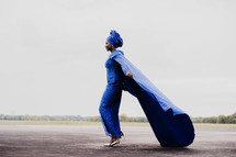 African, ethnic, traditional clothing, blue, woman, cape, standing back to back