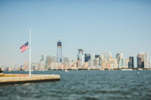 an American flag on a harbor on New York City
