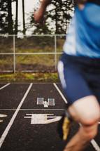 Track runner sprinting