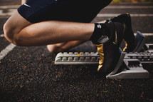 A runner on the starting blocks