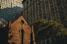 city church amongst skyscrapers