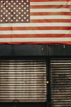 An American flag in a window