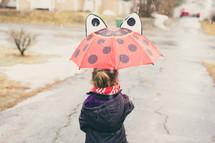 a girl holding up an umbrella