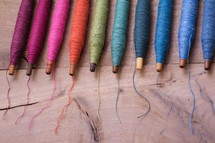 rainbow of spools of thread