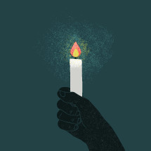 hand holding a candles