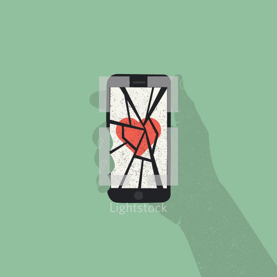 broken cellphone screen with a heart