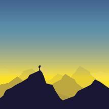 explorer standing on a mountain peak