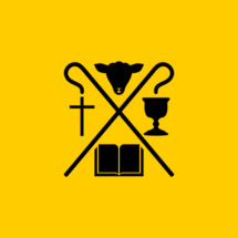 Christian symbols. The Bible, the cross of Jesus Christ, the sacrificial lamb and the cup of communion.