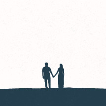 silhouette of couple holding hands.