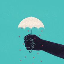 Hand holding an umbrella.