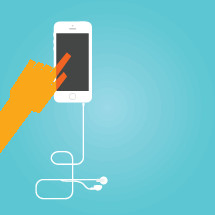 A hand points to a cell phone with earphones attached.