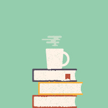 a coffee mug on a stack of books
