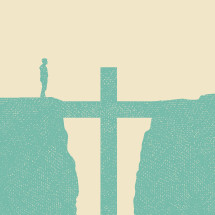 man standing on a cliff and a cross in the gap