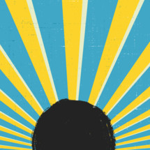 starburst of light behind a black circle