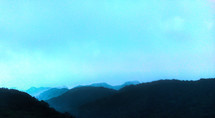 mountain peaks and blue hazy sky
