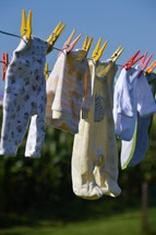 baby clothes drying at a laundry line. birth, birth announcement,  family, baby, clothes, washing, toddler, happy, dry, wet, drying, outdoor, hanging, hang, new, Christmas, born, newborn, little, small, child, children, kid, kids, playsuit, babygrow, rompers, romper suit, babywear, wear, wearing, baby clothes, baby garments, garments, clothesline, line, clothes line, laundry, laundry line, washing line, dry off, air, offspring, junior, generation, grow, growing, growth, descendants, descendant, increase, increasing, fruitful, birth