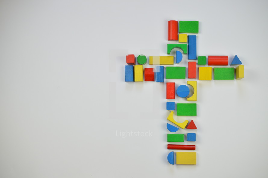 cross of colorful toy wooden blocks