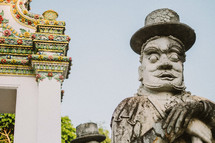 Stone statue in front of a temple in Thailand