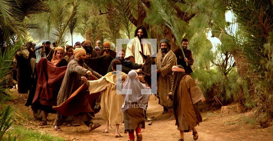 Jesus comes to Jerusalem as King riding a donkey