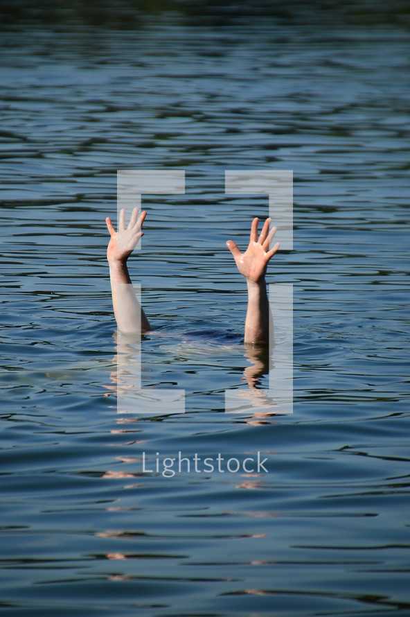 hands raised out of the water for help