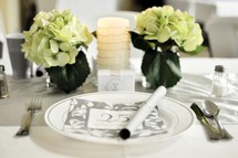 a place setting for a 25th wedding anniversary dinner party