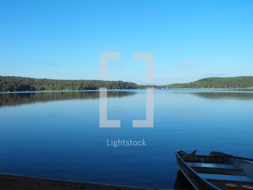 row boat on a lake shore