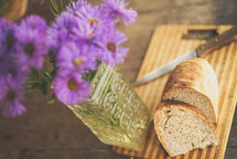 sliced bread and flower in a vase