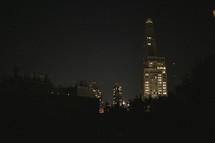lights in the windows of a city sky scraper