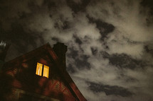 A light shining from an upstairs window