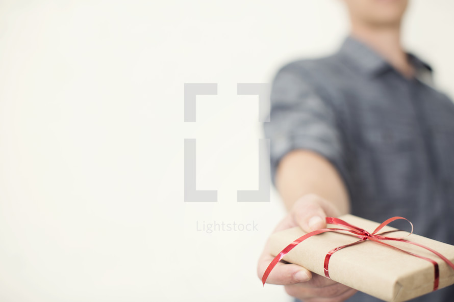 Hands holding a Christmas gift.