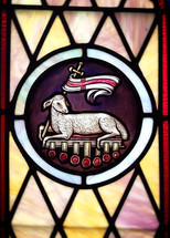 stained glass window of the lamb of God