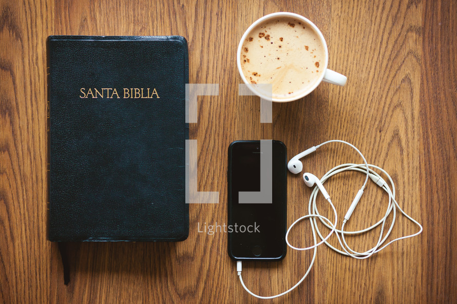 Santa Biblia, earbuds, iPhone, and cappuccino