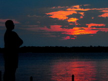silhouette of a man and a pink sky at sunset