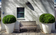 wood bench in front of a building outdoors