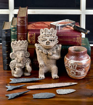 artifacts and collectibles on a wooden table