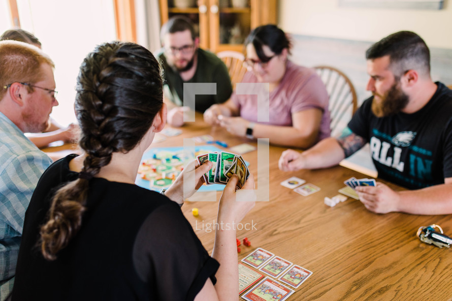 families playing board games together