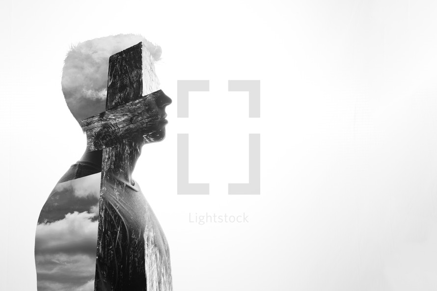 double exposure of a man and empty cross